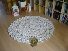 This carpet measures 140 cm in diameter. I used 900 meters of cotton twine (5 mm thick) and a 9 mm crochet hook. The whole work took me about 8 hours. I will post a part of the diagram for this carpet each day starting from December 1st until December 21st. Be sure to visit my blog! http://magiccarpetstudio.blogspot.com/
