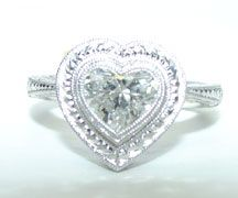 Platinum Heart shaped diamond solitaire with deep relief hand. Great for valentines day!