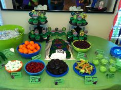 Ninja turtle party ... Kids table-  I like the idea of doing healthy snacks. Oranges, grapes, blueberries, strawberries for each turtle..