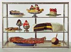 Claes Oldenburg, Pastry Case, I (from The Store), 1961–62, enamel paint on nine plaster sculptures in glass case, 53 × 77 × 37 cm. Courtesy the artists, the Sidney and Harriet Janis Collection, MoMA, New York, and Scala, Florence