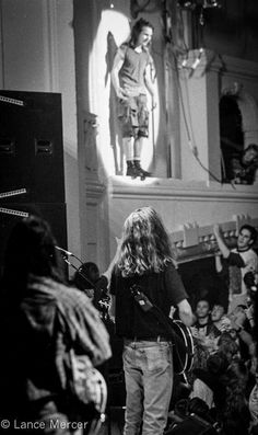 Stone Gossard with Eddie Vedder perched atop the balcony