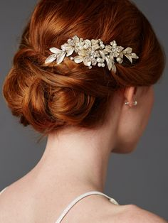 Designer bridal hair comb with hand painted gold leaves and pave crystals This designer hair jewellery is a magnificent statement hair comb for adorning wedding day tresses. The soft brushed golden enamel leaves are nestled against pave crystals flowers and pearl sprays for a dimensional bridal comb boasting romance and beauty. This best-selling headpiece is a customer favorite and a must-have addition to every bridal look.
