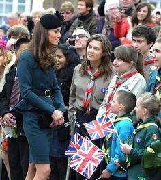 March 2012 - Many had cameras in their hands at the ready to try to grab quick pictures of the Queen, Duke and Duchess, while others waved Union flags and sported hats emblazoned with the union Jack flag