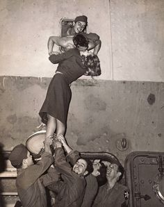 Marlene Dietrich kissing a GI as he arrives home from World War II, New York, 1945 by Irving Haberman