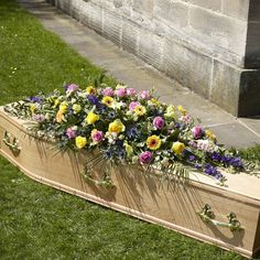 Bright Funeral Flowers for a casket.