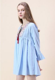 Bright embroidery, a soft blue and a loose silhouette work in perfect harmony to create this casual dress. Slip into a pair of sandals and grab a cross-body bag for a relaxed afternoon look.   - Boho vibe embroidery - V-shape cutout on neck with tassel strings - Bell sleeves - Not lined - 97% cotton, 3% metallised material - Hand wash  Size(cm)Length Bust Waist Shoulder Sleeves S       79    100   126    38      51 M      80    104   130    40  …