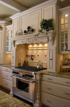 love this...   hood, spice cabinets on side, counter space on both sides with glass cabinets above  Change: drawers below cooktop and add an appliance closet somewhere