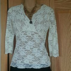 Cabi size medium cream lined lace top Stretchy Cream nude lined lace top in a medium. Fabulous condition, no pulls,  pilling, tears or snags. If you don't tell anyone no one would guess this top was previously worn. Tops Tees - Short Sleeve