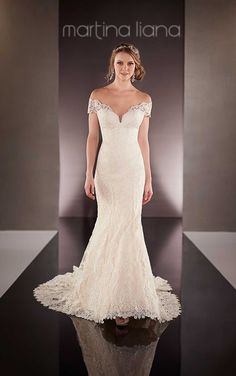 This Parisian Silk Chiffon wedding dress from the Martina Liana bridal gown collection features a hand-placed lace overdress, sexy off-the-shoulder straps, and a scalloped lace hem and elegant train.