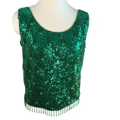 """Vtg Green Beaded Sequin Sparkle Top Pinup Formal Vtg Green sequin and beaded lined Top Metal Zipper Back  Beading in diamond lattice design with 3 beaded strands at each point and dangling strands at hem Nice condition with good structure, there may be some missing sequins.  Some discoloration under arm at interior lining.  ?------measurements------- (all taken with the garment laying flat)  Chest - 20"""" Length 21-1/2"""" waist - 19"""" sweep 19"""" across at hem Armhole 8-1/2"""" Green is a little…"""