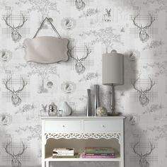 This stunning wallpaper features a collection of beautifully illustrated woodland animals such as a stag, squirrel and hedgehog in a soft charcoal grey. They are set on a pale grey background with metallic silver highlights for added effect.