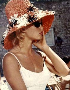 Brigitte Bardot wears a straw hat, 1961
