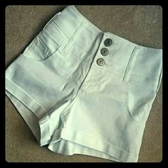 NWOT high Waisted white short shorts New white shorts from Rue21. Cut the tags off, but these have never been worn. High Waisted. 9.5 inches from crotch to top, waistband 30 inches. Lots of stretch. These were too big for me. Size 5/6. Rue 21 Shorts Jean Shorts