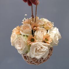Bridesmaids flower ball idea with rattans