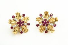 TIFFANY & CO RUBY AND DIAMOND EARRINGS.  American, 20th century. 14k yellow gold in a starburst pattern set with 11 faceted rubies and 10 single cut diamonds each. Sold at Garth's Auctions on December 9, 2015 for $2,640.