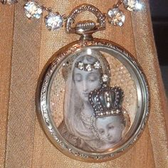 Assemblage necklace created by combining an Art Deco silver paste choker with an antique pocket watch case. Images from an antique lace holy card of the Virgin Mary embracing Baby Jesus are embellished with a diamond paste tiara and a rare antique diamond paste crown.