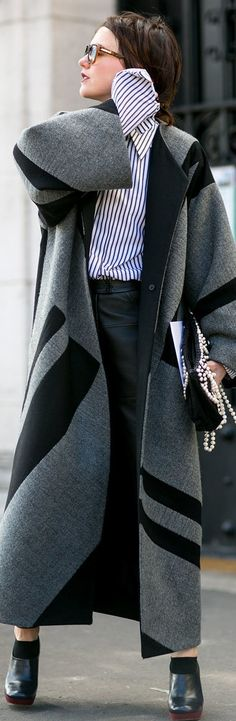 Paris Fashion Week street style: a floor length coat paired with clogs and a striped button down