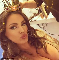 Eyes up here! The brunette beauty took to Instagram to give her social media fans quite an eyeful in an extreme plunging gold dress which focused all the attention on her cleavage