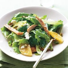 Toasted pistachios and spiced chicken elevate this winter salad to a special main course; salty feta complements the sweet oranges.