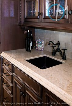 Durango granite countertop with dark cabinets and subway tile backsplash #home #decor