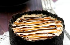 Reese's Peanut Butter Pie from oreos, butter, cool whip, peanut butter, powdered sugar and peanut butter cups!