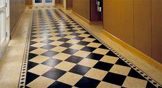 Marmoleum flooring - very creative use - using marmoleum boarders and checkboard tiles on the diagonal