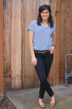 chain necklace, stripey t-shirt, black jeans, brown flats