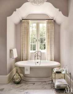 "While purple and lilac are not at the top of my list of favorite colors, I do like the ""Violet Pearl"" shade by Benjamin Moore that was selected for the master bathroom. It's subtle and it's taupe undertones look very pretty with the fittings throughout the space tub space"