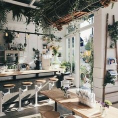 Very lush and botanical, yet rustic, industrial, and somehow spare