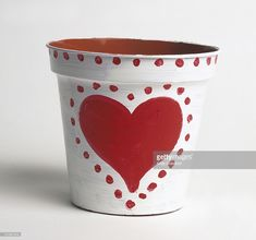 Foto de stock : Empty plant pot painted with love heart and dots