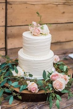 Elegant wedding cake idea - two-tier, buttercream-frosted wedding cake with blush flower topper + tree slice cake stand - perfect for a garden wedding {Andrea Hallgren Photography}