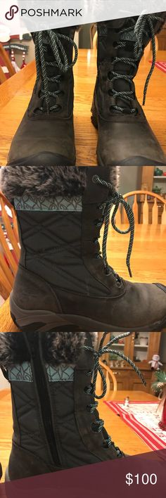 Keen Women's Boots Keen women's boots dark grey with teal strip on top. See pictures. Used very few times last season. Has zipper side and can adjust width of calf with ties. Keen Shoes Winter & Rain Boots