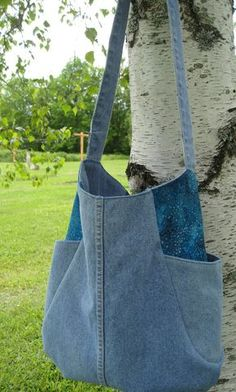 Recycled Denim Tote Bag (Medium).  turquoise fabric accents, side pockets