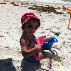 Tessa playing in the sand at the beach.