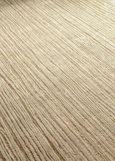 EIK hand tufted rug inspired by wood grain. Made in pure New Zeaand wool.