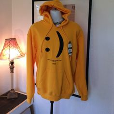 The perfect hoodie, smile God loves you!!! Perfect for the cooler days coming up, never worn. A nice soft yet bright yellow.. 50% cotton 50% polyester, this is pre-shrunk. Still has tags would make a cute Christmas gift!!! This is a size small but will fit a bust up to 36. I think it is a unisex shirt so it's probably more like a medium in a woman size Tops Tees - Long Sleeve