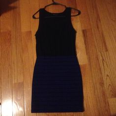 Black/Blue Forever21 Dress This dress is black at the top and blue with black horizontal stripes at the bottom. There is also a tiny pocket on the right side (in photos but hard to see). The top seems thin but my bra has never shown through. If you have any other questions just let me know! Forever 21 Dresses Midi