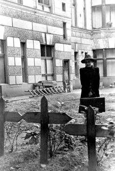 A woman returns to the graves of her family in Berlin after the war.