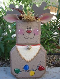 This is one of my Patio People. It is made from a concrete paver and painted with Patio Paint (like everything else I paint) to stand up to Painted Bricks Crafts, Brick Crafts, Painted Pavers, Snowman Crafts, Christmas Projects, Holiday Crafts, Holiday Decor, Winter Christmas, All Things Christmas