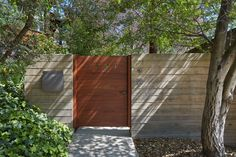 Houe numbering cut into the wooden gate - Backlight this at night and everyone could read that! Mid-Century Modern Renovation by Koch Architects Modern Fence Design, Modern Landscape Design, Modern Landscaping, Midcentury Modern, Wooden Gates, Front Gates, Backyard, Patio, Cool Landscapes