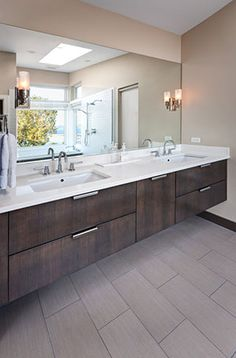 Custom-built wall-mounted vanity made from rift cut white oak with custom stain by Whitney Architecture. Photo via Houzz.