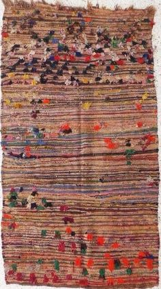could use some of my moroccan wedding blankets for lounge sone or table coverings..Boucherouite Rag Rug <3!