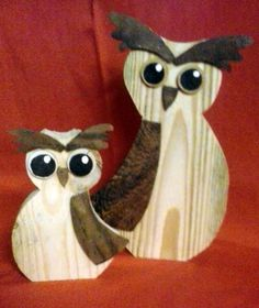 A pair of hand crafted wooden owls self made