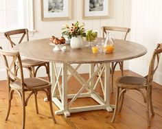 I love this table and chairs---this is the distressed white
