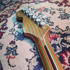 awesome stratocaster neck recycled from skateboards