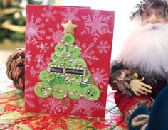 If you have green colored buttons lying at home, you can use them to make a Christmas tree card. All you need to do is to glue the buttons on to the card in the shape of Christmas tree and its done. Christmas Card Craft Idea #Christmas #Parenting PARENTING HEALTHY BABIES