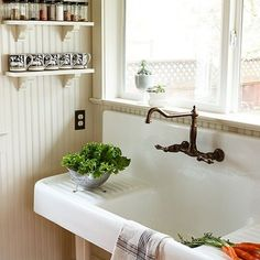 """Feature farmhouse functional  This reproduction sink has slightly tilted drainage boards, """"which are almost like having counter space.""""  Read more: Artful kitchen remodel   Photo: Lincoln Barbour, Sunset.com"""