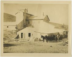 Fairmont Mill, 1908. The corrugated metal building was erected to process cement for the Los Angeles Aqueduct Project and tunnels that were being built at Fairmont Reservoir. The Mill ground 1,200 to 1,500 sacks of tufa cement every 24 hours. Catherine Mulholland Collection. Water Works - Documenting Water History in Los Angeles