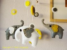 Yellow grey white elephant mobile (FYI-I'm loving the elephants and storing that at the back of my mind for the future!)x