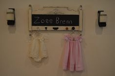 Chalkboard child's crib made into a sign and hanger with vintage knobs. @hilltiffany